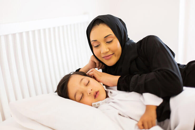 child sleeping with mother watching 770px