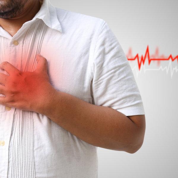 Man clutching his heart - CVD
