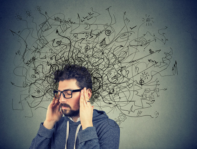 Man stressed - depressed with vectors showing messy head - mental health