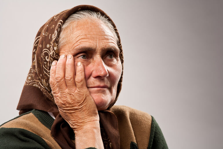 Old woman in headscarf - dementia in the middle east
