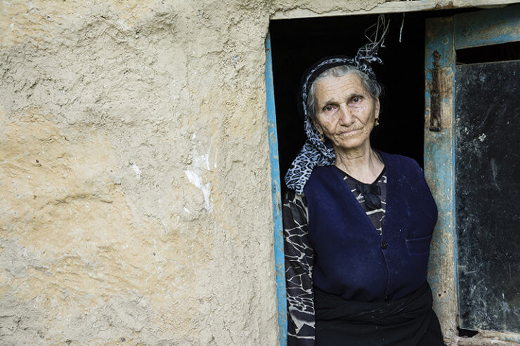 Ageing population in the Middle East - woman stood in doorway