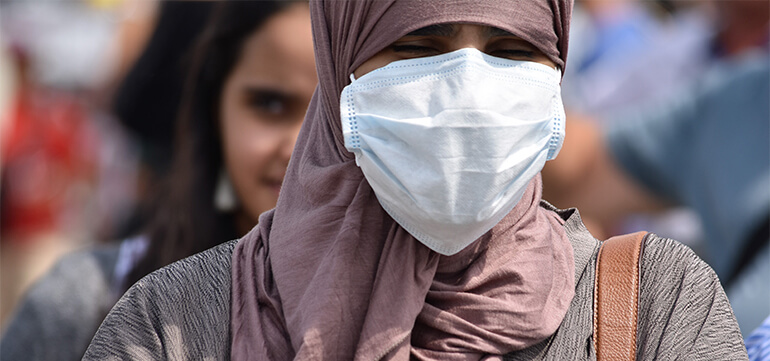 muslim woman medical mask Editorial credit - Shutterstock.com