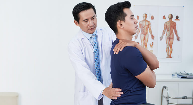 Osteopath and patient - back pain