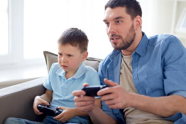 father and son playing game